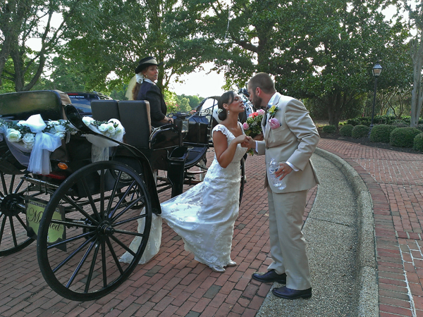 Lovely carriage and just married couple